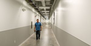 data center technician performing walkthrough